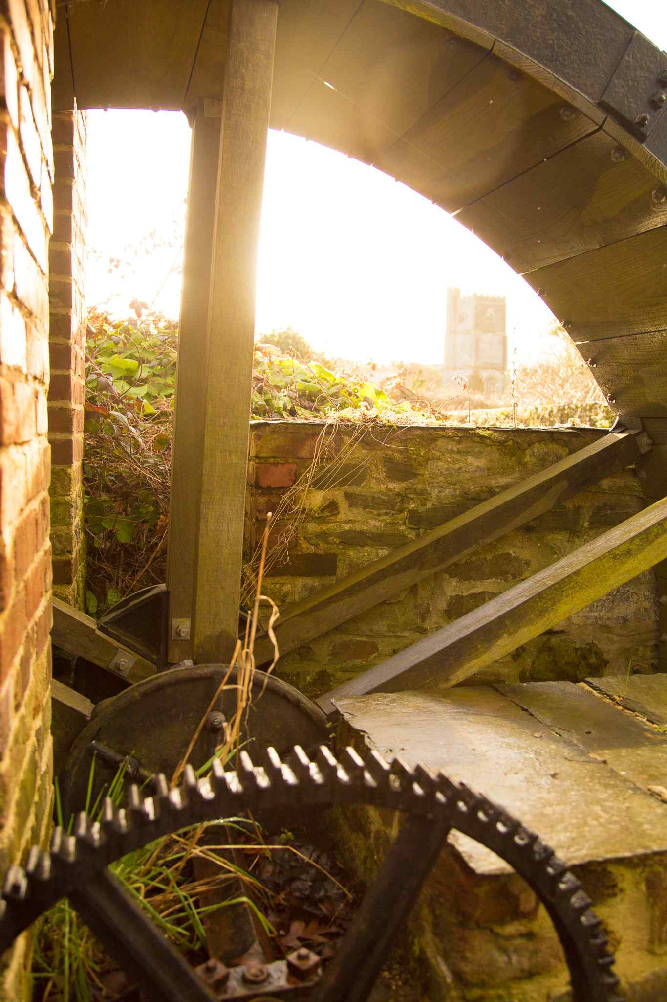 View of church through the waterwheel spokes