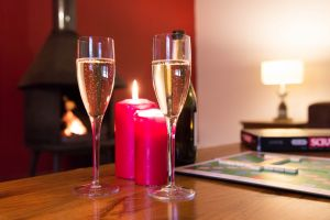 Enjoy a glass of something refreshing in front of a cosy fire
