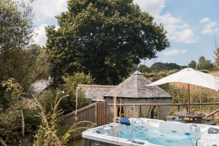 Upper terrace of garden with hot tub