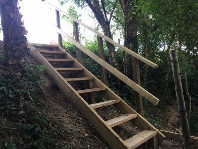 Steps up to glamping meadow