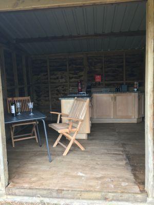 Field kitchen in glamping meadow