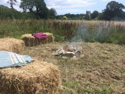 Relax outside your yurt in meadow with fire pit for warmth, to boil a kettle, or for an evening BBQ